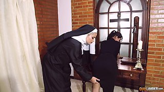 Kinky lesbian spanking and strap on fetish session with a nun