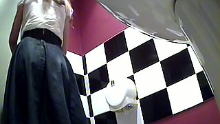 Sweet and sexy blonde woman in the public toilet room got her ass filmed