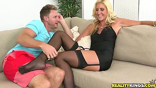 Seductive bitch in short dress and stockings spreads legs wide and shows off her pussy