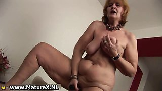 Old naked housewife is sucking big