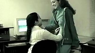 Two horny amateur babes give lesbian sex a try in the office