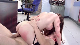 A big dude is sticking his manhood into the office slut in the office