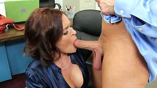 Kinky busty female boss Krissy Lynn swallows sugary cock of Bill Bailey in the office
