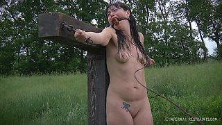 Babe with make up on her face crucified for being a bad girl