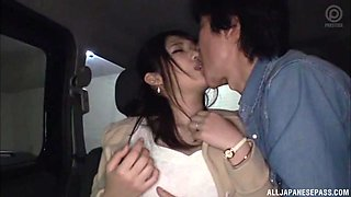 Japanese lassie is in a car with her fella getting pounded big time