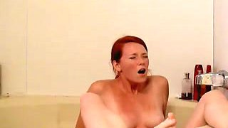 Gorgeous redhead wife reaches orgasm in the bathroom