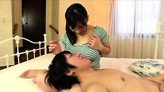 Bodacious Japanese babe has a guy sucking on her big nipples