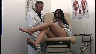 Filthy brunette MILF presents steamy solo in doctor's office