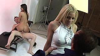 Cindy and her busty mate make group sex with two guys.
