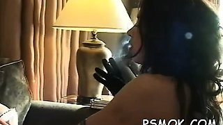 Mature doxy blows a chap while smoking a cigarette