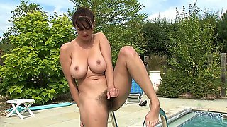 Horny busty babe at the pool